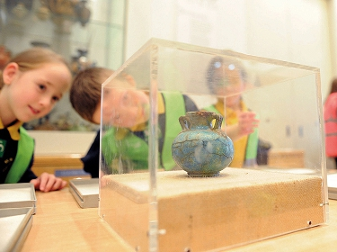 Schoolchildren work with objects in Manchester Museum's Discovery Centre as part of Ancient Egypt and Thunderstones archaeology workshops. Photo: Joe Gardner for Manchester Museum.