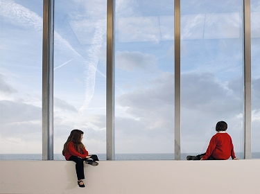 Schoolchildren admire the view from the Clore Learning Studio at Turner Contemporary, Margate